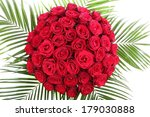 A large bouquet of red roses. The isolated image on a white background. - stock photo