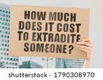 "Small photo of The question "" How much does it cost to extradite someone? "" on a banner in men's hand with blurred background. Crime. Illegal. Persecution. Border control. Unlawful. Arrest. Violation"