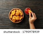 Female Hand Holds Nugget Over...