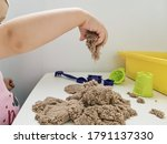 A Child Plays With Kinetic Sand ...