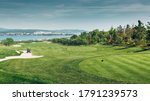 Green Golf Course With Scenic...