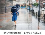 Woman in bad rainy weather...