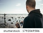 Guy Driving A Quadcopter. A Ma...