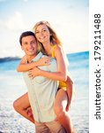 happy couple on the beach at... | Shutterstock . vector #179211488