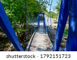 A Wooden Bridge In The Forest