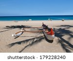 red and white outrigger at...