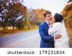 happy newlyweds go on autumn... | Shutterstock . vector #179231834