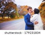 happy newlyweds go on autumn... | Shutterstock . vector #179231834