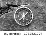 Round Compass On Wooden...