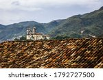 Baroque architecture church in a landscape at the historic colonial town of Ouro Preto, Minas Gerais State, Brazil
