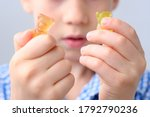 Boy  Kid Holding Sweets In His...