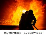 Two Firefighter Holding Fire...
