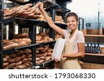 Young Woman Wearing Apron...