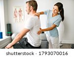 A physiotherapist doing treatment with patient in bright office