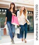 two happy young women shopping... | Shutterstock . vector #179311550