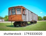 A Wooden Paneled Train Car In...