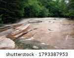 Small photo of Table Rock, Over time, the rushing waters of the Flume Brook exposed this large outcropping of rock. The Flume Gorge, Lincoln, New Hampshire, USA. 8/1/2020
