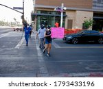 Small photo of TEMPE, AZ/USA - JULY 2nd, 2020: BLM Protesters walking on the crossroad divide into separate, smaller groups to abide by social distance guidelines, on their way to Tempe City Hall for a chalk walk.