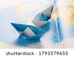 Small Paper Boats On World Map. ...