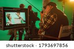 Small photo of Director Gives Commands Shooting History Movie Green Screen CGI Scene with Actors Wearing Renaissance Costumes. Big Film Studio Professional Crew Shooting Big Budget Movie. Back View Shot