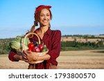 woman farmer holding basket...