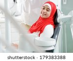 Young teenage girl at dentist's office - stock photo