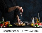 The Chef Prepares A Dish Of...