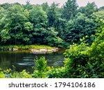 Small photo of Clarion river in Cook Forest State Park in Pennsylvania near the Allegheny National Forest. Lots of green trees along the river!