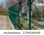 Steel Grill. Green Fence With...