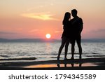 A Young Couple On The Sea At...