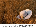 A Large White Summer Wicker Hat ...
