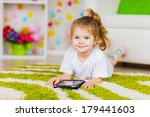 child playing on tablet pc... | Shutterstock . vector #179441603