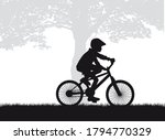silhouette of a child on a bike. | Shutterstock .eps vector #1794770329