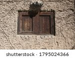old mud wall old house | Shutterstock . vector #1795024366