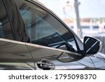 Small photo of Side view of car window tint. Ceramic film provide heat rejection & UV protection with color stable shade. Automobile film installed to glass surface of red car. Car tinting service. Selective focus.