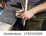 Shoemaker Repairing High Heel...
