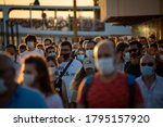 Small photo of People disembarking from the city lines ferry docking at Kadikoy Pier in Istanbul on August 12, 2020. Especially, most of the people who are in a hurry to return to their homes prefer sea transport.
