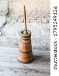 Small photo of Butter churn - old traditional wooden plunger-type butter churn with staff
