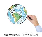 a hand holding a globe  north