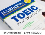 Small photo of NAKHON RATCHASIMA, THAILAND- August 9, 2020: Barron's Toeic book on white table in classroom