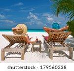 Couple On A Tropical Beach At...