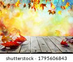 wooden table with orange leaves ...   Shutterstock . vector #1795606843