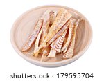 Slices of stockfish on wooden plate. Dried fish fillet, cut into strips. Sliced fish flounder, salted fish beer, beer set on a plate. Isolated image on white background, work path saved. - stock photo
