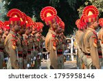 Kolkata, West Bengal, India - 26th Januaray 2020 : Bright and beautiful red hats of Indian Army Officers , while marching past with rifles, at Republic day parade. - stock photo