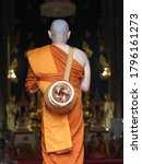 Small photo of Ordination ceremony A young Thai man ordained as a monk at the age of 20 in Bangkok, Thailand.