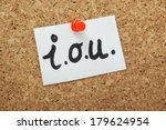 i.o.u note pinned to a cork... | Shutterstock . vector #179624954