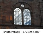 Twin Arched Windows in Stone Wall of Industrial Building