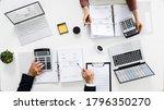 Auditors Calculating Corporate...
