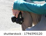Young Male Photographer Restin...