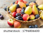 An Assortment Of Raw Fruit In A ...